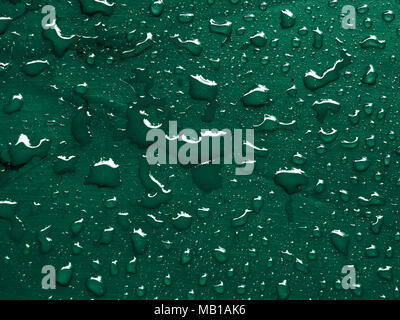 water drops on bottle green metallic surface - Stock Photo