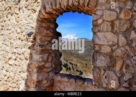 Gran Sasso mountain view from the Rocca Calascio castle window, L'Aquila district, Abruzzo, Italy - Stock Photo