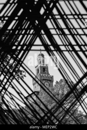 View of the Castello Sforzesco in Milan, Italy on a frame of intelocking cords on the foreground - Stock Photo