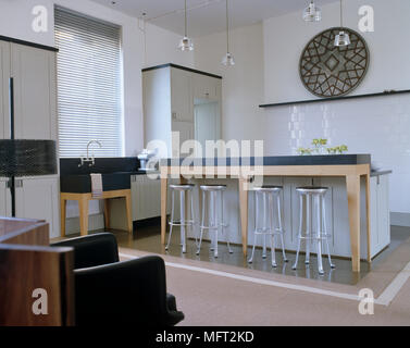 open plan kitchen breakfast bar. stools at the kitchen  Four bar breakfast in white contemporary open plan Stock Photo Breakfast with and living area