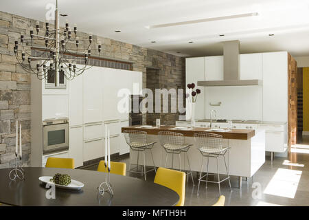 Harry Bertoia bar stools at breakfast in modern open plan kitchen Stock Photo Breakfast with and living area