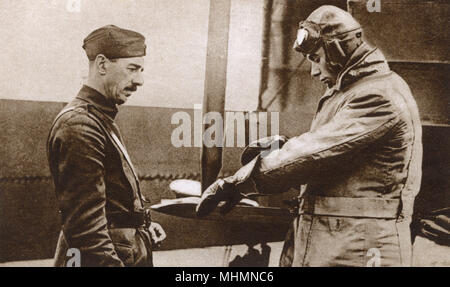 Prince Albert, later Duke of York and King George VI (1895-1952), as a Captain in the Royal Air Force to which he transferred from the Navy in 1918. Here he is preparing for a flight in a Handley-Page bomber at Cranwell, Lincolnshire.     Date: 1918 - Stock Photo