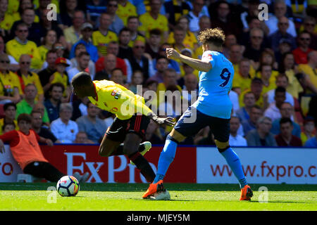 London, UK. 5th May, 2018. Dwight Gayle of Newcastle United (R) tackles Abdoulaye Doucoure of Watford (L). Premier League match, Watford v Newcastle United at Vicarage Road in Watford, London on Saturday 5th May 2018.  this image may only be used for Editorial purposes. Editorial use only, license required for commercial use. No use in betting, games or a single club/league/player publications. pic by Steffan BowenAndrew Orchard sports photography/Alamy Live news - Stock Photo