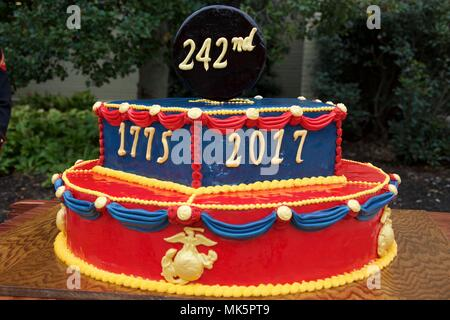 A cake is displayed at a Marine Corps birthday ceremony at the Stock