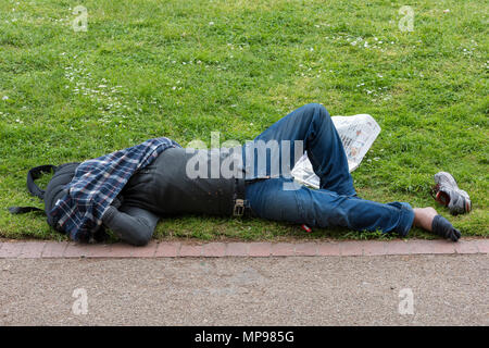 Homeless drunk man sleeping it off on the beach Stock Photo: 18882362 - Alamy