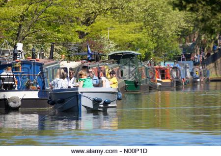 London, UK. 5th May 2018. UK Weather: Londoners enjoy sunny day at Canalway Cavalcade narrowboats festival in Little Venice. Credit: Marcin Rogozinski/StockimoNews/Alamy Live News - Stock Photo