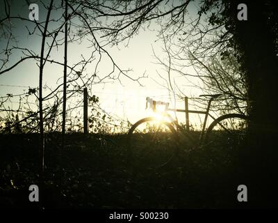 Silhouette of bicycle with Sunrise - Stock Photo
