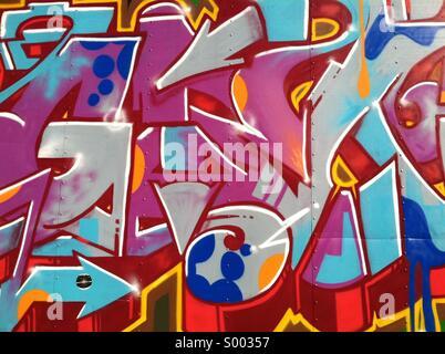 A wall of random colorful graffiti - Stock Photo