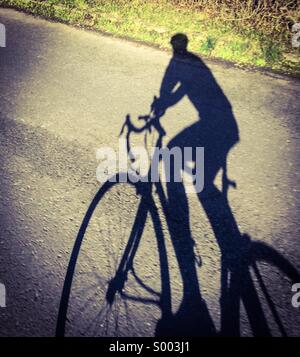Road bike shadow - Stock Photo