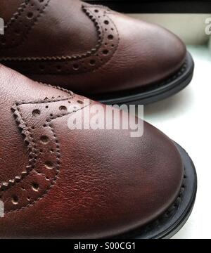 Details on a brown wingtip brogue - Stock Photo