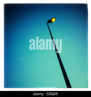 Street lamp post at sunset - Stock Photo