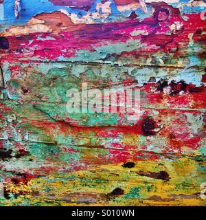 Distressed paint on abandoned wooden shipwreck - Stock Photo
