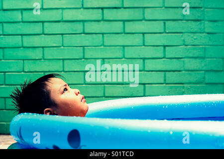 Kid in a kiddie pool - Stock Photo