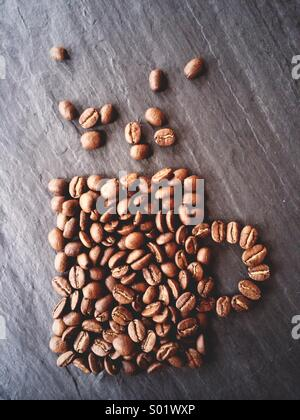 Coffee beans shaped to resemble a cup of coffee. - Stock Photo