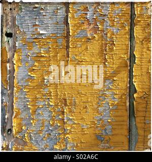 Wooden panel with peeling paint for background - Stock Photo
