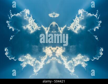 Sunlight be hide the symmetry cloud look like a big wings of bird or angle - Stock Photo