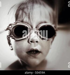Boy wearing swimming goggles - Stock Photo
