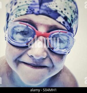 Portrait of smiling boy with goggles - Stock Photo