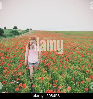 Girl in a poppy field - Stock Photo