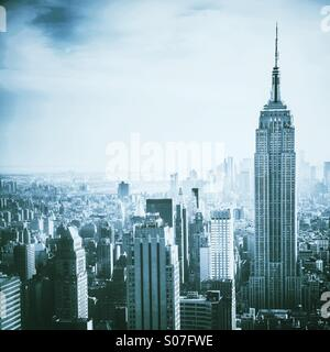 Aerial view over Manhattan, NYC including Empire State Building - Stock Photo
