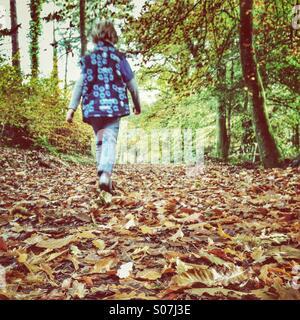 Walking through fallen leaves - Stock Photo