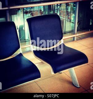 Empty seats at the departure gate - Stock Photo