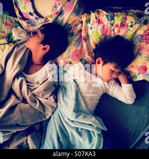 Two sleeping brother kid top view - Stock Photo