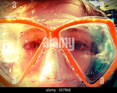 Underwater eyes - girl diver wearing goggles - Stock Photo