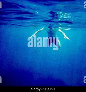 Shark attack !                                               A man swimming viewed from underwater - Stock Photo