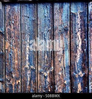 Peeling blue paint on a old door - Stock Photo