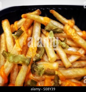 French fries with cheese and green chillies, served at Burger King, Dubai, UAE - Stock Photo