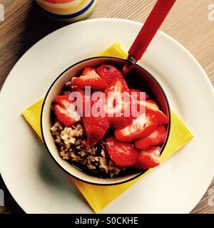 Strawberries and Porridge Breakfast Bowl - Stock Photo