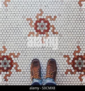 Tile floor and feet - Stock Photo