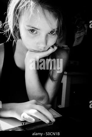 Girl with ipad and notebook - Stock Photo