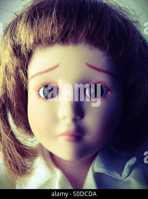 The face of a sad doll. - Stock Photo