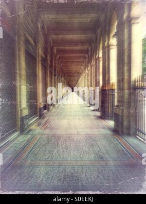 Arcade of Valois Gallery at Palais-Royal early in the morning. 1st arrondissement or district in central Paris, - Stock Photo