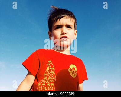 Three years old boy in a red t-shirt - Stock Photo