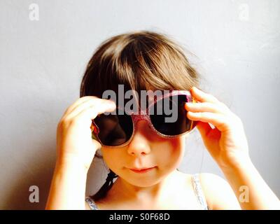 3-year old girl wearing sunglasses - Stock Photo