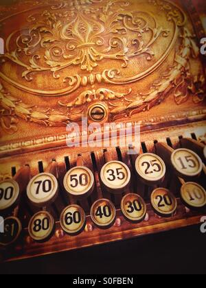 Vintage ornate brass cash register - Stock Photo