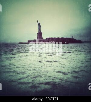Statue of Liberty across the river - Stock Photo