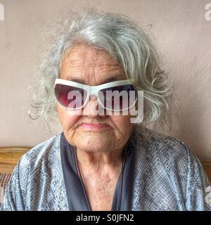 Elderly woman with sunglasses - Stock Photo