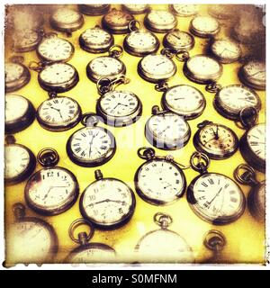 Collection of vintage pocket watches in Genadendal museum. - Stock Photo
