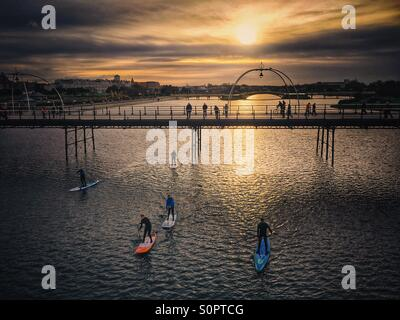 Stand up paddle boarding  on Marine Way lake at Southport - Stock Photo