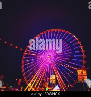 Neon light with heart shape in perish wheel - Stock Photo