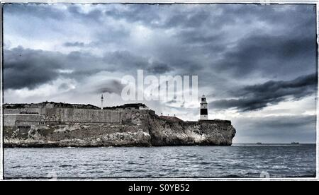 Europa Point lighthouse Gibraltar from seaward - Stock Photo