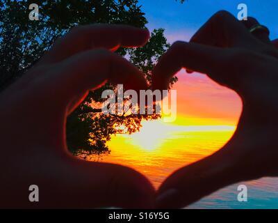 Sunset to wow the honeymooners - Stockfoto