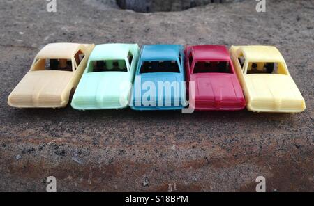 Five vintage toy plastic model cars - Stock Photo