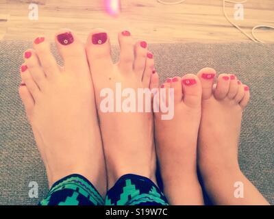 Matching summer toenails - Stock Photo