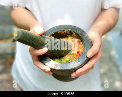 Namprik - Thai chili shrimp paste in stone mortar - Stock Photo