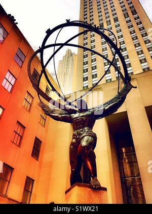 Atlas holding up the world statue , Rockefeller Center, NYC - Stock Photo